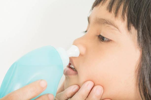 Nasal wash  And sinusitis in children stock photo