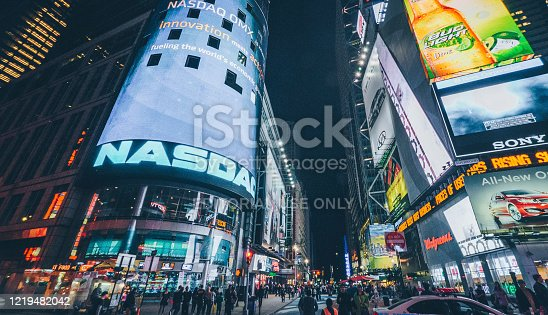 Nasdaq Stock Exchange billboard at Times Square full of tourists. Iconified as