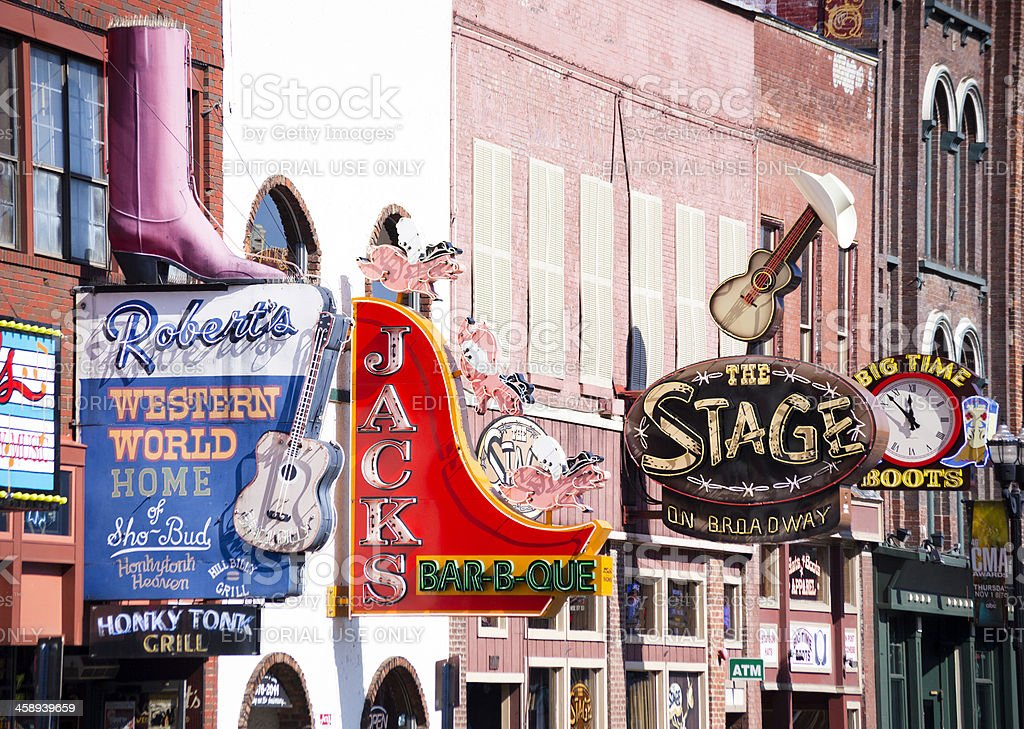 """Nashville, Broadway Street, Honky Tonk Bars """"Nashville, USA - October 22, 2012: different colorful signs identificates shops and Honky Tonk bars located on Broadway Street in Nashville."""" Bar - Drink Establishment Stock Photo"""