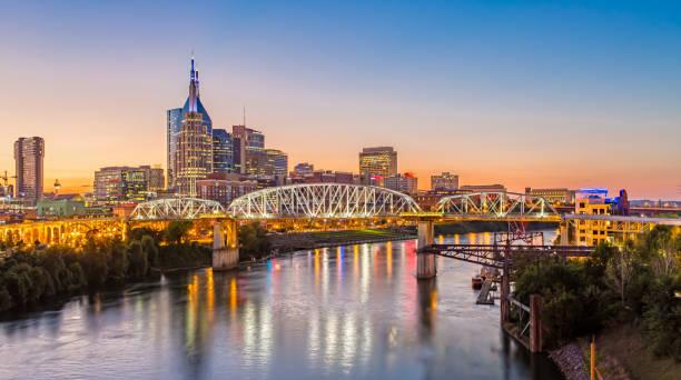 Nashville Skyline and John Seigenthaler Pedestrian Bridge at Dusk stock photo