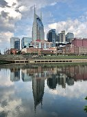 Nashville skyline with reflection in the Cumberland River on a cloudy day