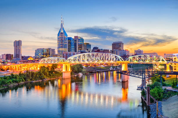 Nashville, Tennessee, USA Nashville, Tennessee, USA downtown skyline on the Cumberland River. tennessee stock pictures, royalty-free photos & images
