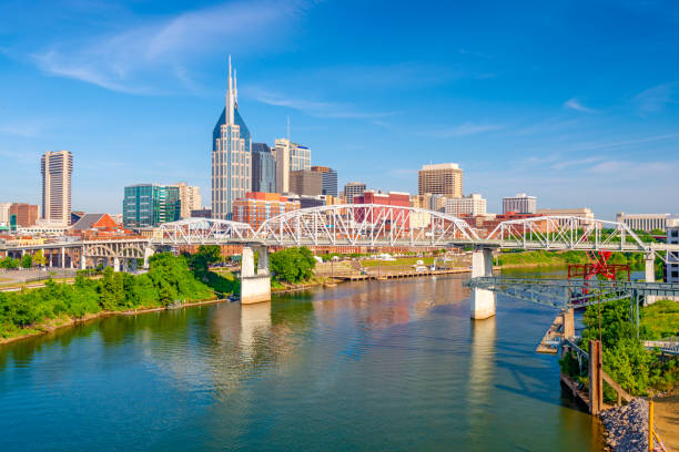 Nashville, Tennessee, USA Skyline Nashville, Tennessee, USA downtown city skyline on the Cumberland River. tennessee stock pictures, royalty-free photos & images