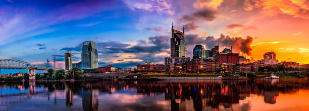 Nashville, TN skyline Nashville TN Skyline with Cumberland river in view tennessee stock pictures, royalty-free photos & images