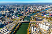 Nashville, United States - November 7, 2020:  Aerial view of the downtown skyline of Nashville Tennessee along the banks of the Cumberland River shot from an altitude of about 1200 feet.