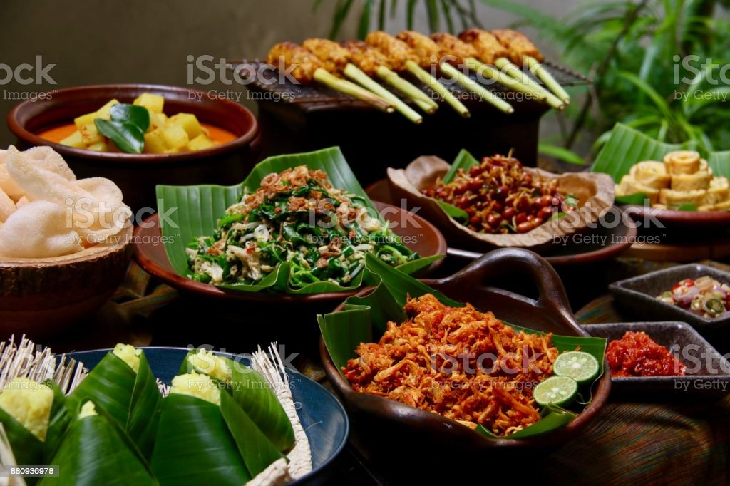 Nasi Campur Bali, a Popular Balinese Dish of Rice with Variety of Side Dishes stock photo