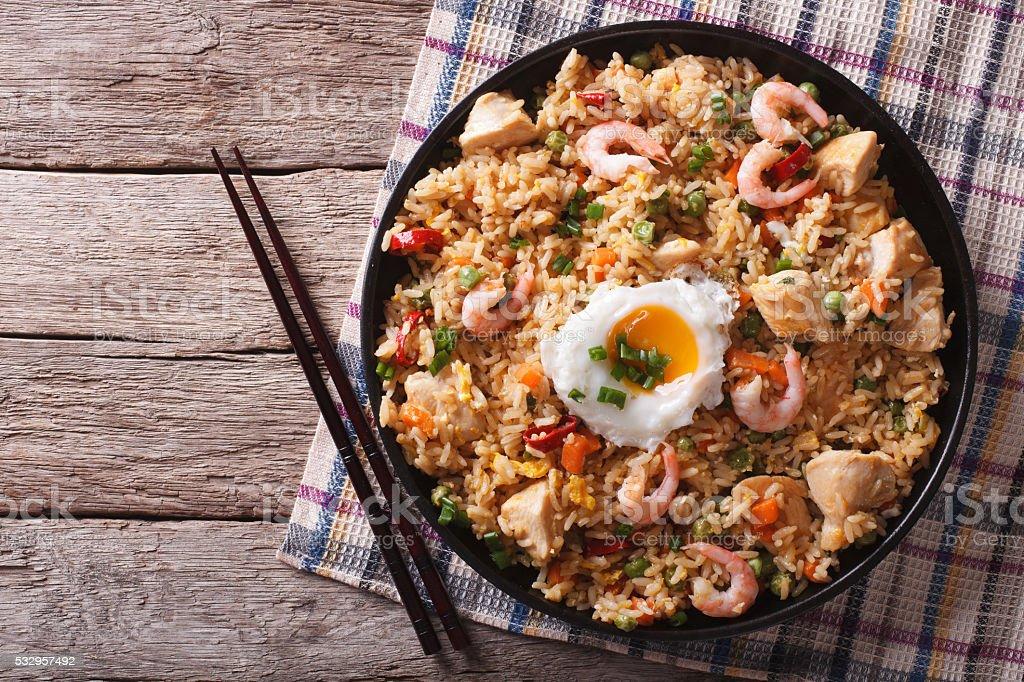 nasi goreng with chicken, prawns, egg and vegetables horizontal stock photo