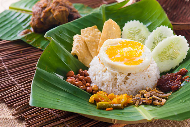 Nasi Kemal, a traditional Malay dish served in a leaf stock photo