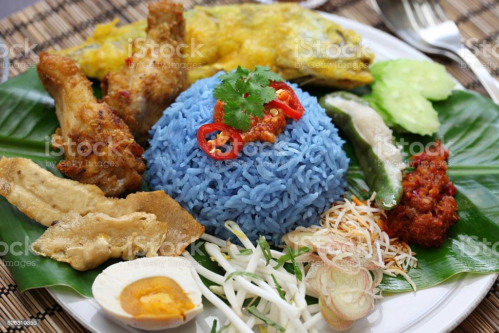 nasi kerabu, blue color rice salad, malaysian cuisine stock photo