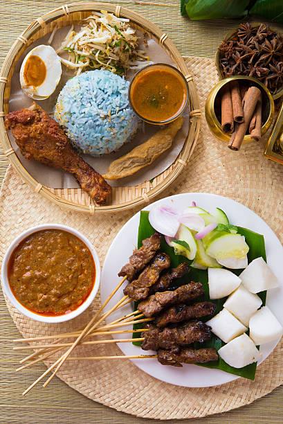 Nasi kerabu or nasi ulam, popular Malay rice dish. stock photo