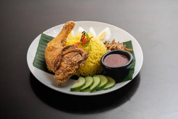 Nasi Lemak with fried chicken Close up photo of Malaysia's traditional food nasi lemak ayam goreng malaysia nasi lemak stock pictures, royalty-free photos & images