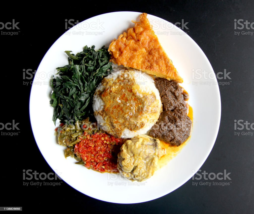 Nasi Padang with Rendang Nasi Padang with beef rendang, brain cow curry and omelet Beef Stock Photo