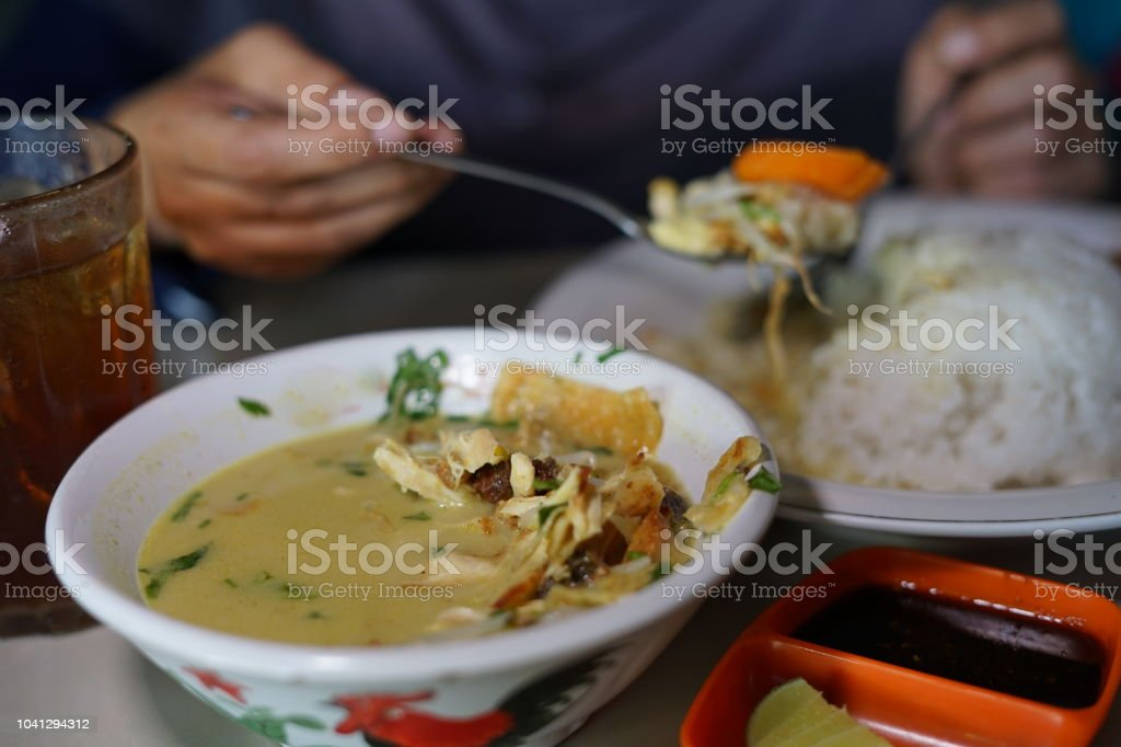 Nasi Soto Ayam, the Traditional Chicken Soup with Rice From Indonesia stock photo