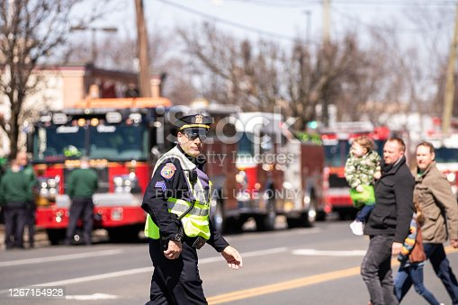 Wantagh, New York - March 17, 2019 : Nassau County police officer directing traffic before the beginning of the first Annual St. Patrick's Day Parade. Long Island