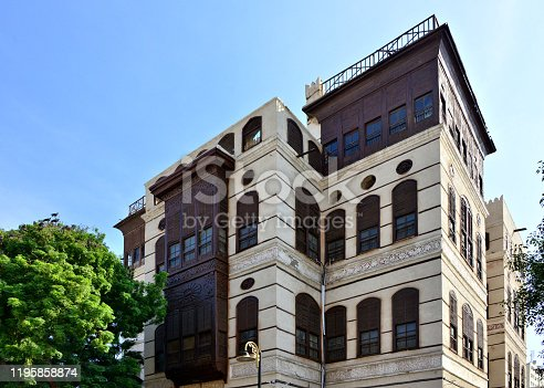 Jeddah, Mecca Region, Saudi Arabia: Nassif House / Beyt Nassif - hedjazi architecture with Turkish influence, Al Balad district, al-Alawi Street - building with Arabian closed wooden balconies (rawasheen / mashrabiyas). Built between 1872 and 1881 by Sheikh Umar Effendi al-Nassif, served as a residence for King Abul Aziz Ibn Saud in 1925 when he entered the city as a conqueror. Constructed of limestone bearing walls reinforced with wooden beams. The façade is covered with limestone plaster. The house is also known as
