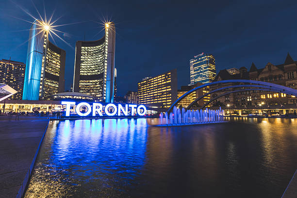 nathan phillips square in toronto at night - toronto stock pictures, royalty-free photos & images