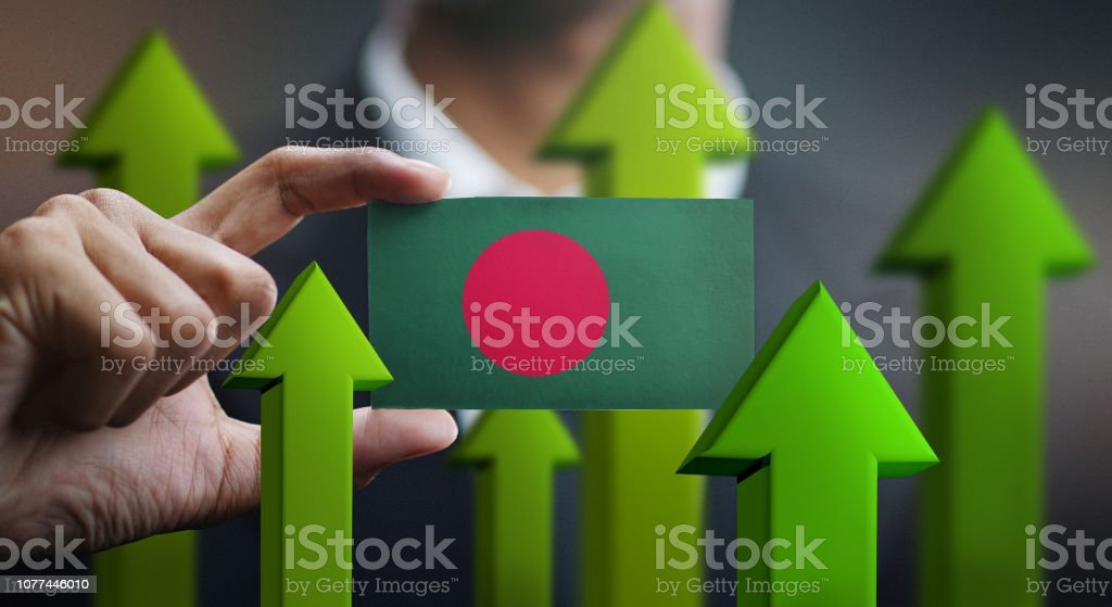 Nation Growth Concept, Green Up Arrows - Businessman Holding Card of Bangladesh Flag stock photo