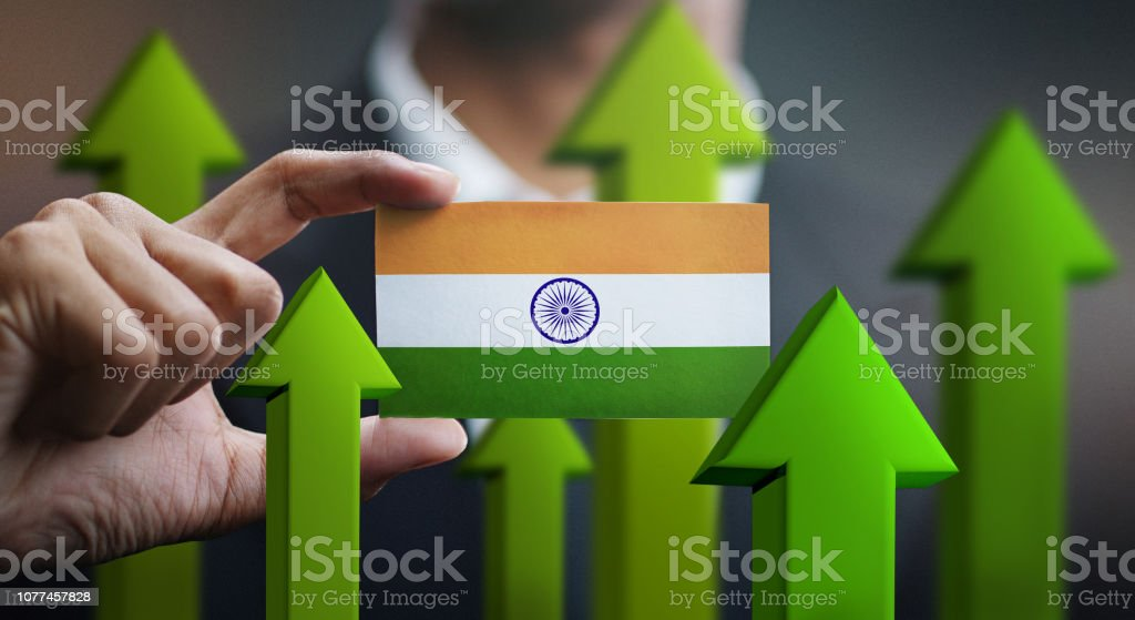 Nation Growth Concept, Green Up Arrows - Businessman Holding Card of India Flag Nation Growth Concept, Green Up Arrows - Businessman Holding Card of India Flag Abstract Stock Photo