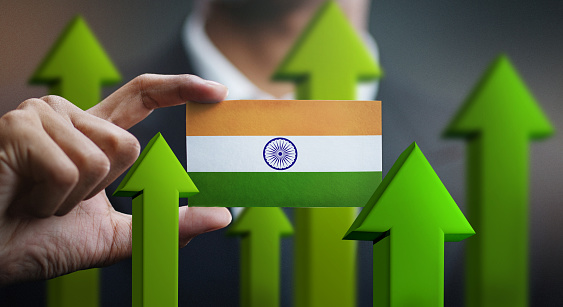 Nation Growth Concept Green Up Arrows Businessman Holding Card Of India Flag Stock Photo - Download Image Now
