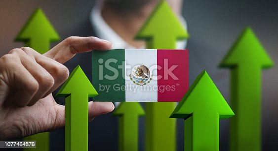 Nation Growth Concept, Green Up Arrows - Businessman Holding Card of Mexico Flag