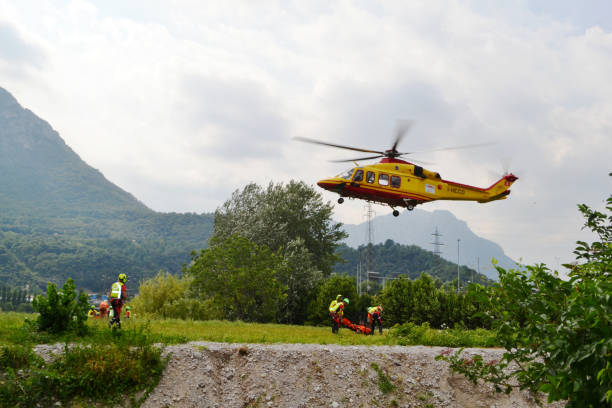National Alpine rescue team of Lecco is exercising in rescue with the help of helicopter. stock photo
