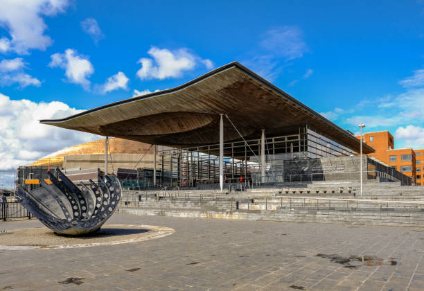 Cardiff Bay, Wales - May 20, 2017: National Assembly building Sinedd, National Assembly building.  Front view with sculpture in the foreground. wales stock pictures, royalty-free photos & images