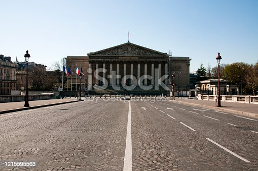 Palais Bourbon : National Assembly building (Assemblée Nationale ) with empty streets during epidemic Coronavirus, in 2020 in Europe. People must be at home and be confine. Stores, restaurants, schools, museums.... are closed. Paris, France. March 25, 2020