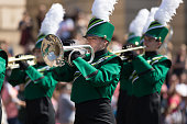 Washington, D.C., USA - April 14, 2018 Marching Band members playing trumpets in the 2018 National Cherry Blossom Parade