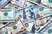 istock USA national currency, top view of mixed American dollars banknotes 1212581566