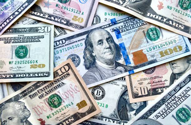 USA national currency, top view of mixed American dollars banknotes stock photo
