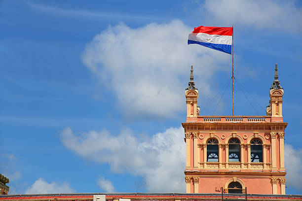 National flag flying above Presidential Palace in Asuncion, Para stock photo