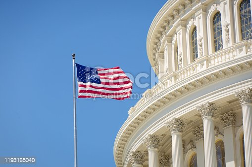 istock U.S. National Flag in Front of U.S. Capitol in Washington DC 1193165040