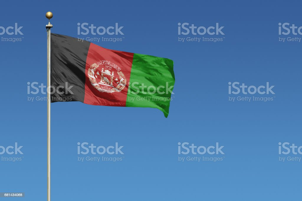 National flag of Afghanistan on clear blue sky stock photo