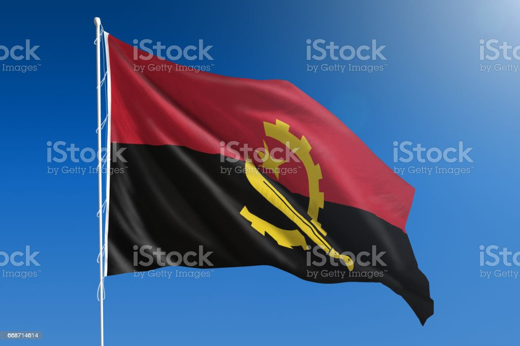 National flag of Angola on clear blue sky stock photo