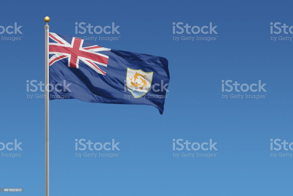 National flag of Anguilla on a clear blue sky stock photo