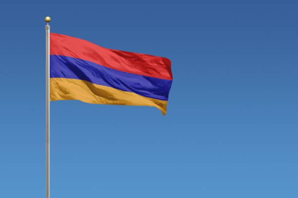 National flag of Armenia in front of a clear blue sky The National flag of Armenia armenia country stock pictures, royalty-free photos & images
