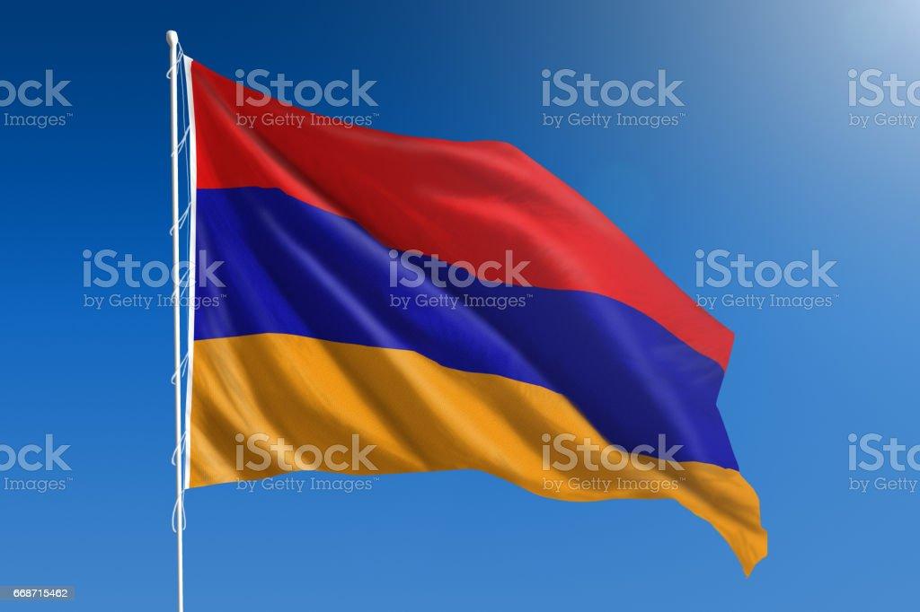 National flag of Armenia on clear blue sky stock photo