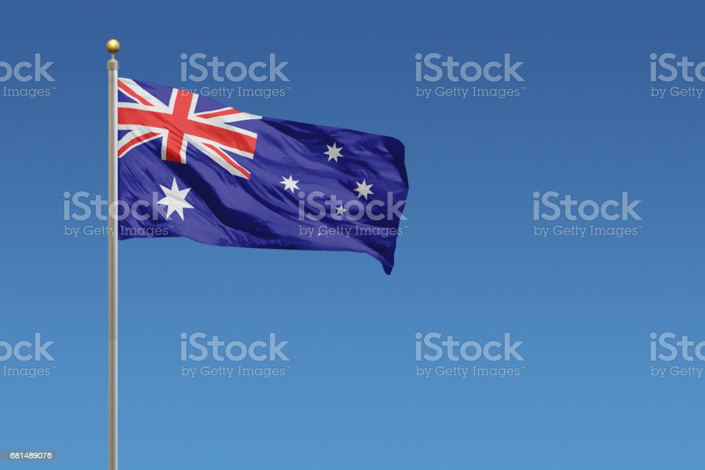 National flag of Australia on a clear blue sky stock photo