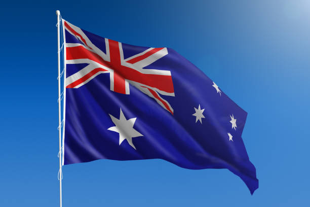 National flag of Australia on clear blue sky stock photo