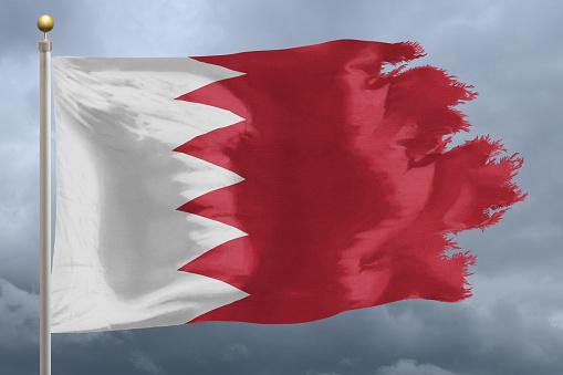 National flag of Bahrain with torn edges