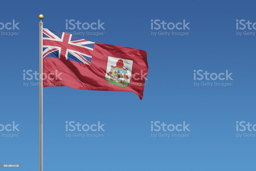National flag of Bermuda on a clear blue sky stock photo