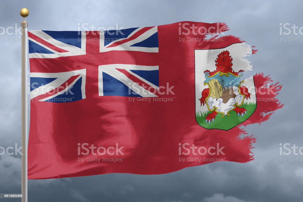 National flag of Bermuda torn and blowing during storm stock photo