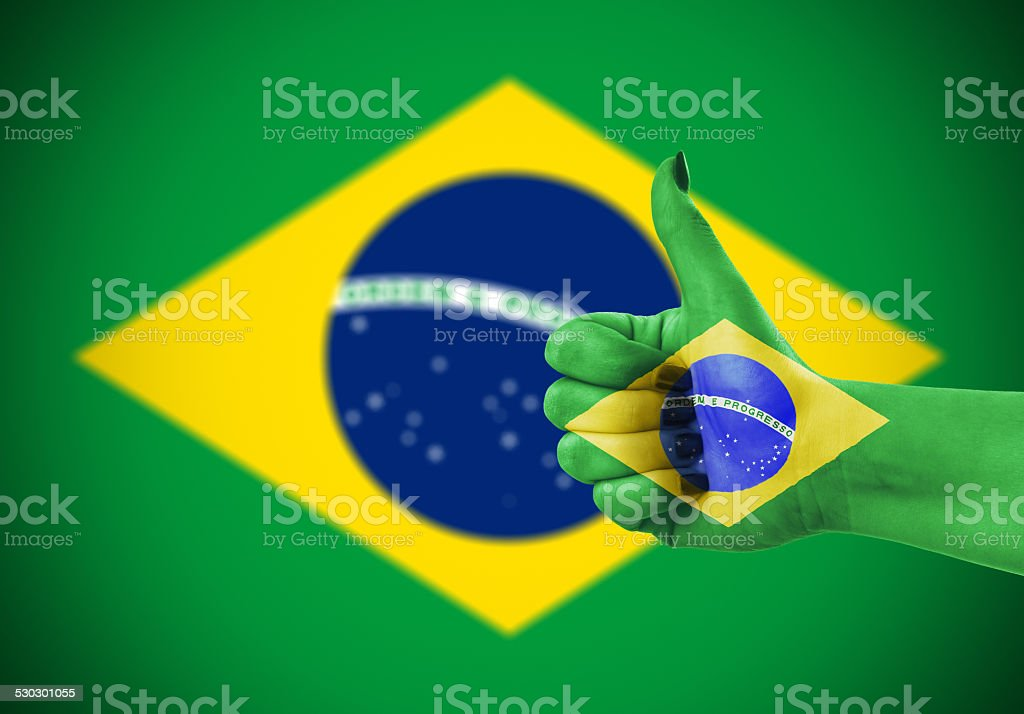 National flag of Brazil on hand stock photo