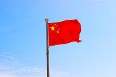 Flag of China in sky. Hainan island, China. Selective focus