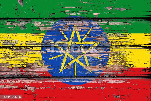 1058533662 istock photo National flag of  Ethiopia on a dull wooden background 1022109016