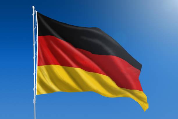 drapeau national de l'allemagne au claire ciel bleu - drapeau allemand photos et images de collection