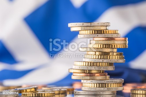 istock National flag of greece and euro coins - concept. Euro coins. Euro money. Euro currency. 909395114