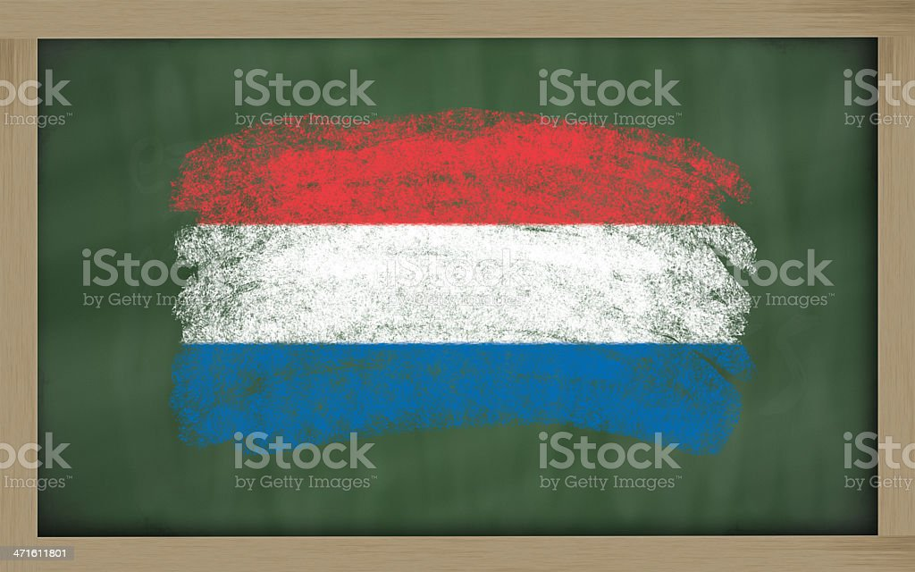 national flag of holland on blackboard painted with chalk royalty-free stock photo