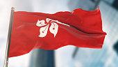 National Flag of Hong Kong Against Defocused City Buildings