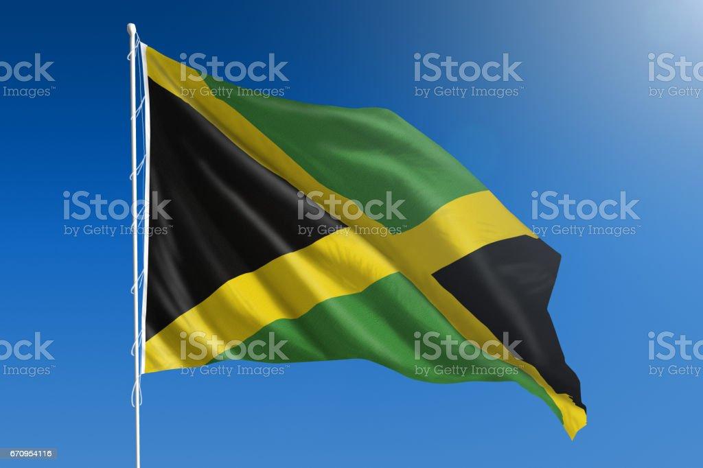 Bandeira nacional da Jamaica no claro céu azul - foto de acervo